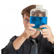Royalty-Free Stock Photo: Man checks physical properties of liquid in bottle