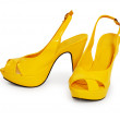 Stock Photo: Pair of yellow female shoes isolated on white background