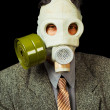 Portrait of person in a gas mask on black background — Stock Photo