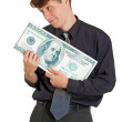 Businessman is nursed with money on white — Stock Photo