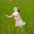 Child cheerfully plays with ball — Stock Photo