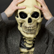Amusing scared person in mask - skull — Stock Photo