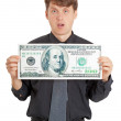 Funny stupid man holding a big money — Stock Photo