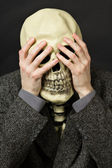 Skeleton covering his eyes — Stock Photo