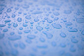 Abstract background - water drops on blue plastic — Stock Photo