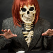 Stock Photo: Amusing skeleton with red hair - Halloween