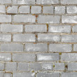 Brick wall with atmospheric destruction — Stock Photo