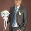 Happily smiling groom with bunch — Stock Photo #3676429
