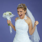 Bride in white dress shouts with happiness — Stock Photo
