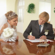 Stock Photo: Groom and bride - registration of marriage