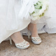 Royalty-Free Stock Photo: Shoes of bride under wedding dress