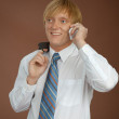 Young man talks by mobile phone — Stock Photo