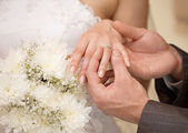 Hands of groom and bride with ring close up — Stock Photo