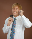 Young man talks by mobile phone — Stockfoto