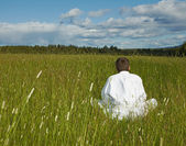 Person is meditation far away from civilization — Stock Photo