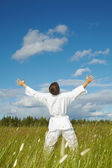 Happy person rejoices lives on nature — Stock Photo