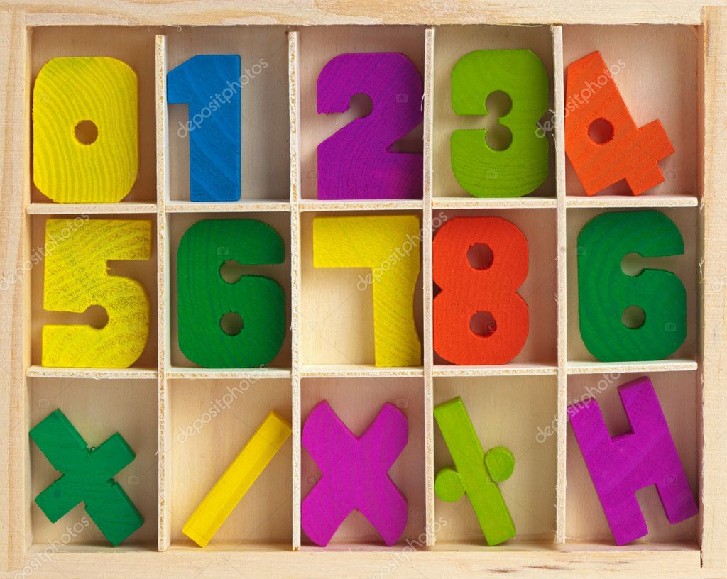 Wooden set for training to arithmetics of children — Stock Photo #3737191
