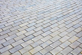 Surface covered with gray bricks — Stock Photo