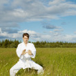 Young man is training in Wushu — Stock Photo