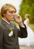 Groom speaks by phone , forgotten about bride — Stock Photo