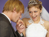 Gallant groom kisses hand — Stock Photo