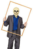 Man dressed as skeleton in wooden frame — Stock Photo