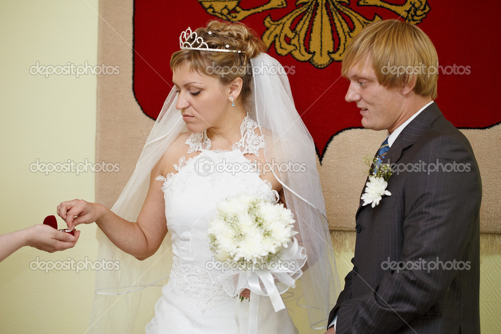 The moment of wearing of wedding rings at wedding ceremony  Stock Photo #3834134