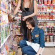 Stock Photo: Two women choose food
