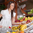Woman choose food  in  supermarket — Stock Photo