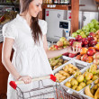 Stock Photo: Womchoose food in supermarket