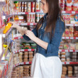 Girl choose food in supermarket — Stock Photo #2910701