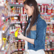 Girl choose food in supermarket — Stock Photo