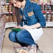 Girl choose food in supermarket - Foto de Stock  