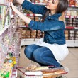 Stock Photo: Woman choose food in supermarket