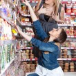 Two woman choose food in supermarket — Stock Photo