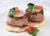 Meat beef with fua-gra and truffles — Stock Photo