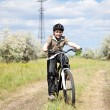 Boy riding bike in a helmet - Stock Photo