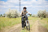 Boy riding bike in a helmet — Stock Photo