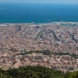 Postcard panorama view of Barcelona from the Tibidabo hill - Stock Photo