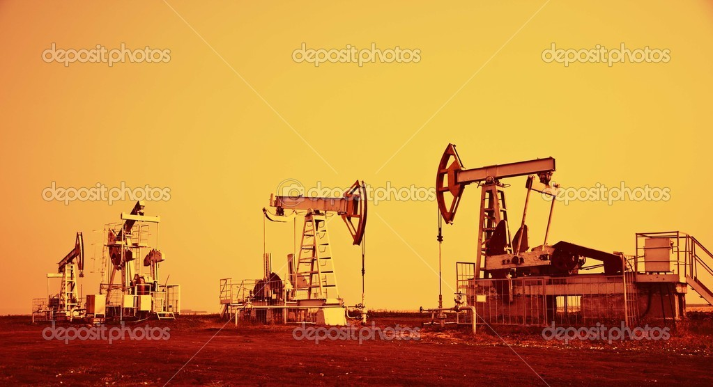 Oil pump jack.Orange filtered image. — Stock Photo #3621927
