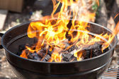 A grill with charcoal and flames — Stock Photo