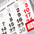 An October calendar showing the 31st prominently — Stock Photo