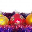 Christmas tinsel and toys — Стоковое фото