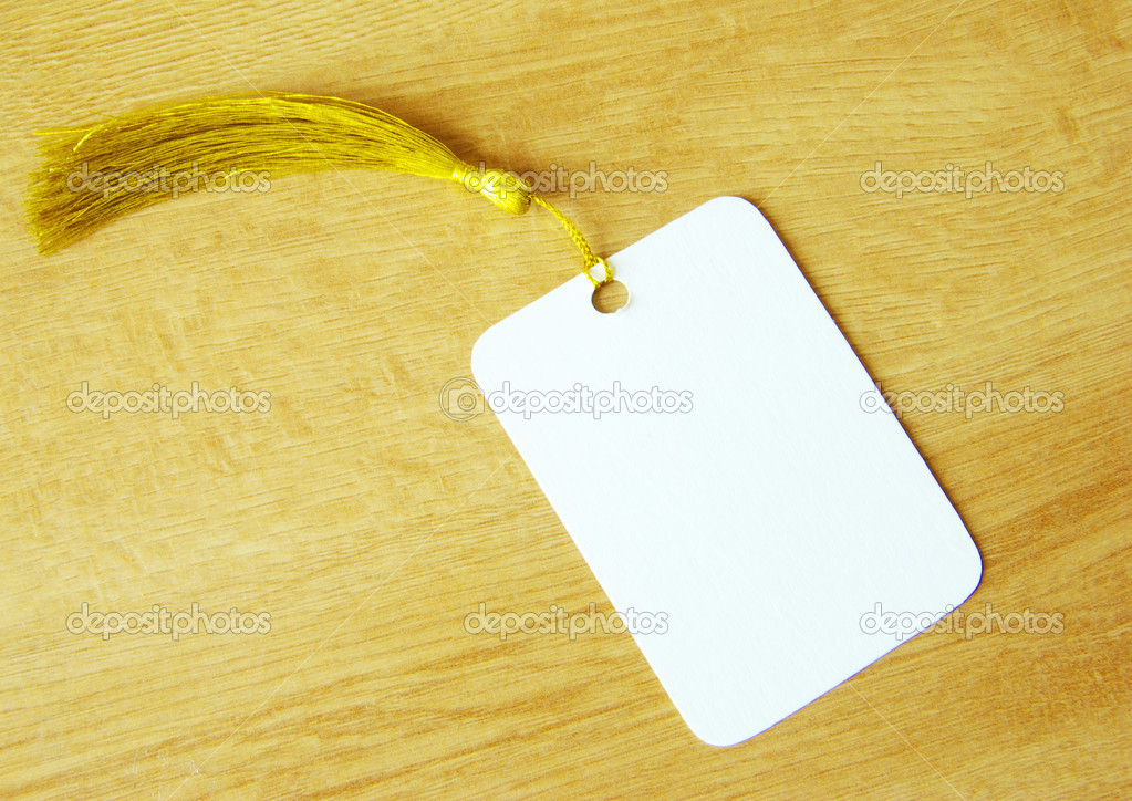 Blank tag isolated on a wooden background — Stock Photo #3238267