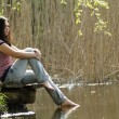 Girl resting near lake — Stock Photo
