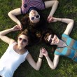 Girls laying on grass — Stock Photo