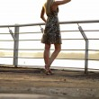 Blond lady walking over promenade — Stock Photo