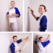 Woman tries on wall-papers to wall — Stock Photo