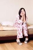 Young beautiful brunette woman waking up — Stock Photo