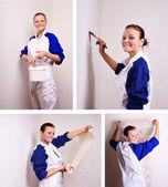 Kobieta próbuje na fototapety na ścianę — Zdjęcie stockowe